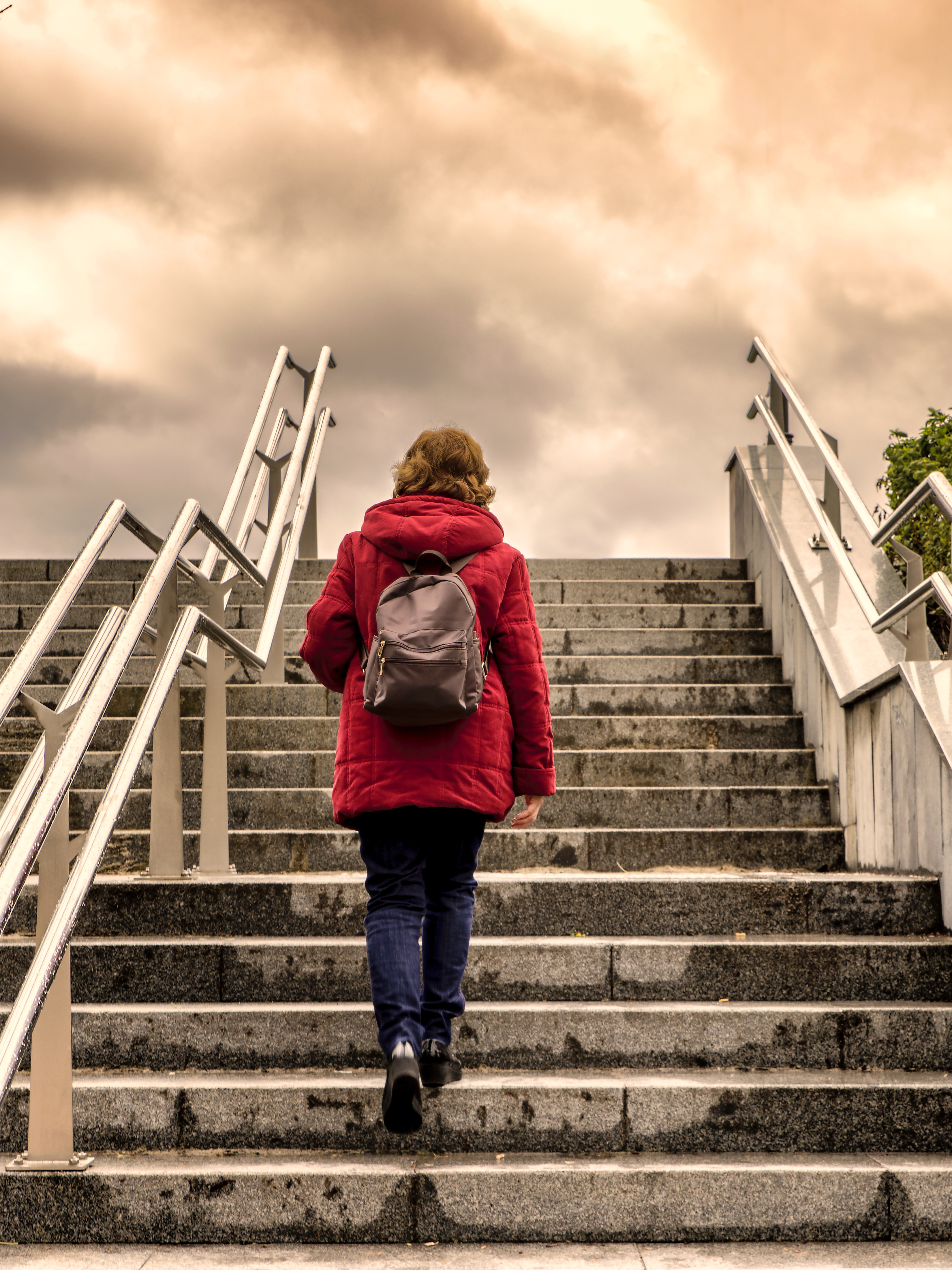 traveller woman  climbing stairs to the sky